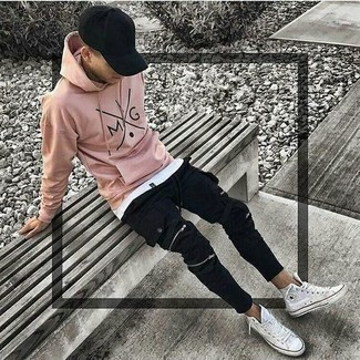 500+ Relaxed Outfits For Men: For an off-duty outfit, consider pairing a pink print hoodie with black cargo pants — these items play really well together. White canvas high top sneakers are a great choice to finish off your outfit.