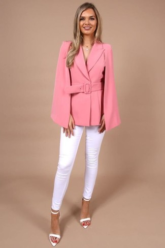 How to Wear a Hot Pink Cape Blazer: Opt for a hot pink cape blazer and white skinny jeans for a casual ensemble with a modern take. White leather heeled sandals will bring a little glamour to your outfit.