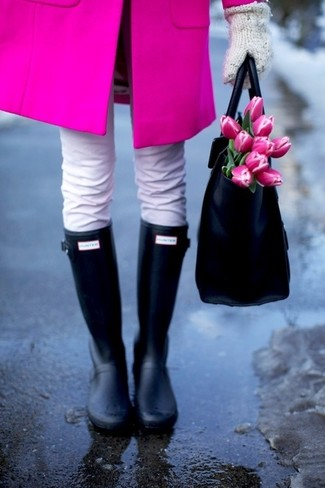 Consider wearing a hot pink coat and white jeans for both chic and easy-to-wear look. A pair of black rain boots brings the dressed-down touch to the ensemble.