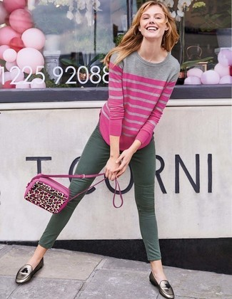 This combination of a hot pink striped crew-neck jumper and dark green skinny jeans is clean, chic and very easy to recreate! Add a glam twist to your ensemble with silver leather tassel loafers. You can bet this getup will become your go-to come spring.