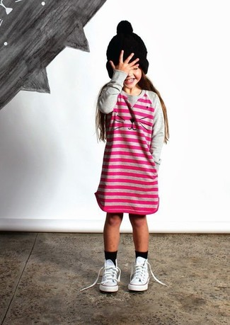 How to wear: hot pink horizontal striped dress, white sneakers, black beanie, black socks