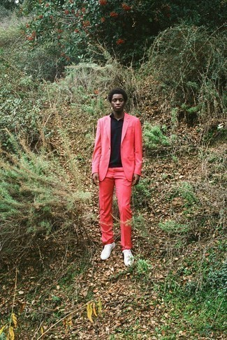 Black Polo Outfits For Men: Make a black polo and a hot pink suit your outfit choice if you seek to look on-trend without making too much effort. Grab a pair of white canvas low top sneakers to give a touch of stylish effortlessness to this ensemble.