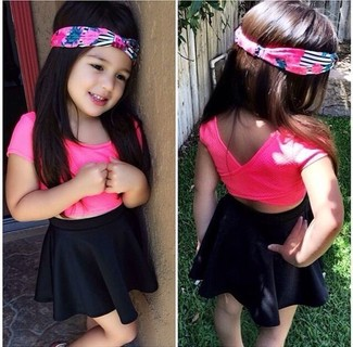 Girls' Looks & Outfits: What To Wear In Summer: Go for a hot pink t-shirt and a black skirt for your little angel for an easy to wear, everyday look.