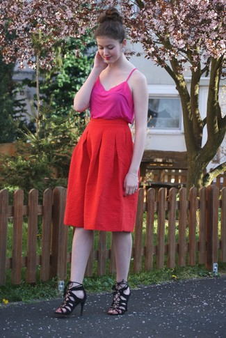 This pairing of a neon pink tank and a red pleated midi skirt is simple, totally stylish and oh-so-easy to replicate! Make heeled sandals your footwear choice to kick things up to the next level. One actually can to keep your cool under the oppressive heat, and this getup is a clear example of just that.