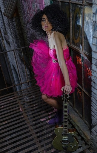 Show off your playful side in deep pink tulle party dress. Purple suede lace-up flat boots are a great choice to complete the look.