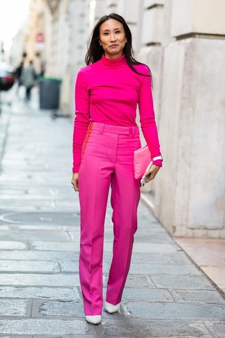 How to Wear White Leather Pumps: This combination of a hot pink turtleneck and hot pink dress pants is beyond versatile and creates instant appeal. If you don't know how to round off, complement your look with a pair of white leather pumps.