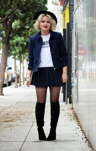 Pairing a jacket with a navy pleated mini skirt is a comfortable option for running errands in the city. A pair of black suede knee high boots will seamlessly integrate within a variety of outfits.