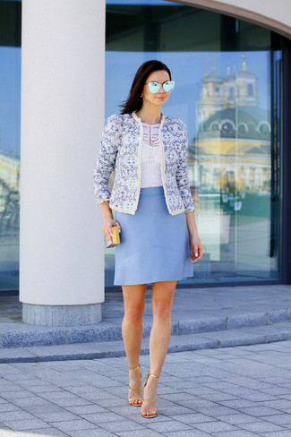 A light blue print jacket and a light blue leather a-line skirt are appropriate for both smart casual events and day-to-day wear. This outfit is complemented perfectly with gold leather heeled sandals.
