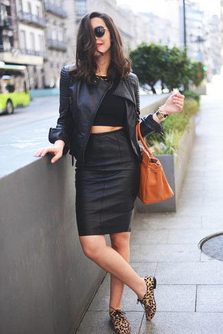 Rock a black cropped top with a black leather pencil skirt for a work-approved look. This outfit is complemented perfectly with camel animal suede oxford shoes.