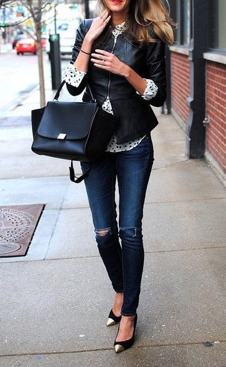 A black leather jacket and deep blue distressed skinny jeans is a wonderful combination worth integrating into your wardrobe. For the maximum chicness make black suede pumps your footwear choice.