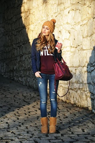 A navy quilted jacket and blue distressed slim jeans is a nice combination to carry you throughout the day. Mix things up by wearing brown uggs.