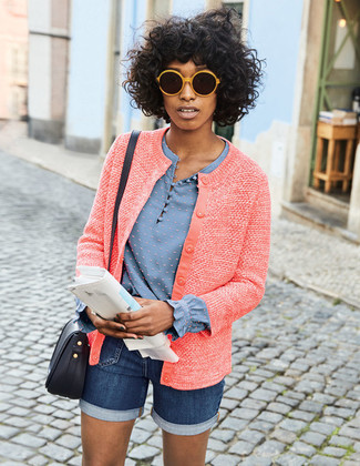 Pairing a red tweed jacket with navy blue denim shorts is a comfortable option for running errands in the city.