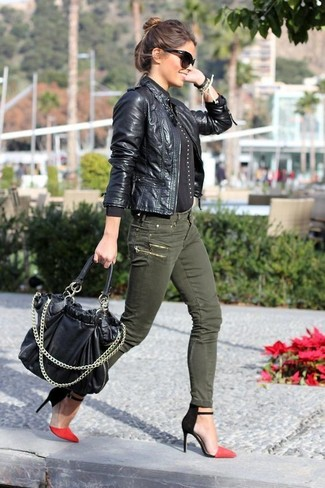 If you're a fan of classic pairings, then you'll like this combination of a black leather jacket and olive skinny jeans. Round off this look with red and black suede pumps.