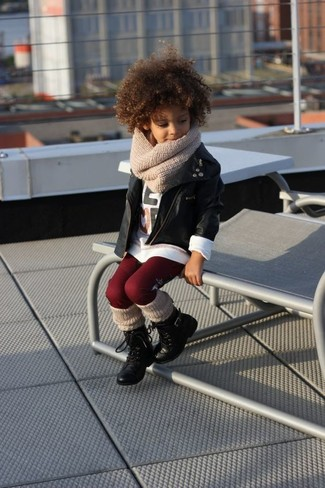 How to Wear a Black Leather Jacket For Girls: Suggest that your mini fashionista wear a black leather jacket with burgundy leggings for a fun day in the park. Black boots are a good choice to complete this style.