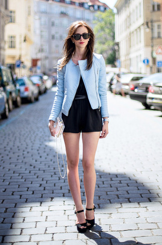 Pairing a light blue leather jacket with a black playsuit is a comfortable option for running errands in the city. Black suede heeled sandals will add a touch of polish to an otherwise low-key look.