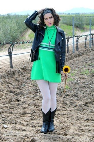 Reach for a black fringe leather jacket and a green shift dress to feel confidently and look fashionably. For footwear go down the casual route with black leather cowboy boots.