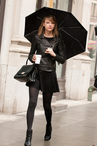 Consider wearing a black leather jacket and a black skater dress and you'll look like a total babe. Black leather ankle boots are a smart choice to complete the look.