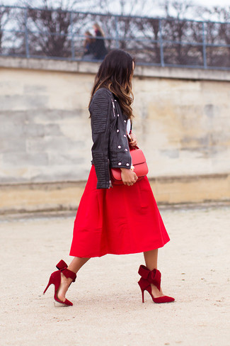 Wear a black leather jacket with a red pleated midi skirt to ooze class and sophistication. A pair of red suede pumps will seamlessly integrate within a variety of outfits.
