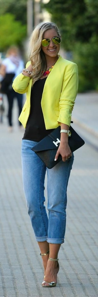 A yellow jacket and blue skinny jeans is a versatile combination that will provide you with variety. Gold leather heeled sandals are a smart choice to complete the look.