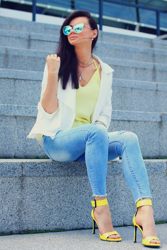 Go for a white jacket and baby blue ripped slim jeans to achieve a chic look. This outfit is complemented perfectly with yellow leather heeled sandals.