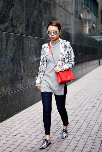 If you're a fan of classic pairings, then you'll like this combination of a white and black graphic jacket and deep blue slim jeans. Round off this look with silver leather oxfords.