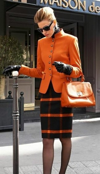 Show off your sophisticated side in an orange wool jacket and a black plaid wool pencil skirt.