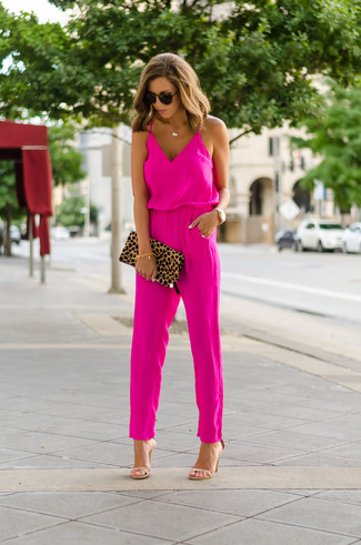 How to wear: hot pink jumpsuit, tan leather heeled sandals, tan leopard suede clutch, dark brown sunglasses