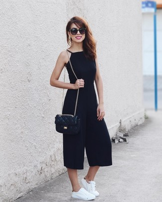 How to wear: black jumpsuit, white leather low top sneakers, black quilted leather crossbody bag, black sunglasses
