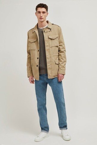 How to wear: khaki field jacket, olive crew-neck sweater, blue jeans, white leather low top sneakers