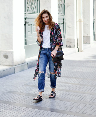 This combo of a black floral kimono and blue distressed boyfriend jeans gives off a very casual and approachable vibe. This outfit is complemented perfectly with black leather flat sandals.