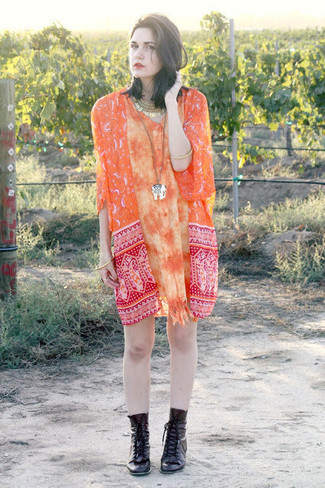 Choose an orange print kimono and an orange shirtdress for a comfy-casual look. Dress up this look with black leather lace-up ankle boots.