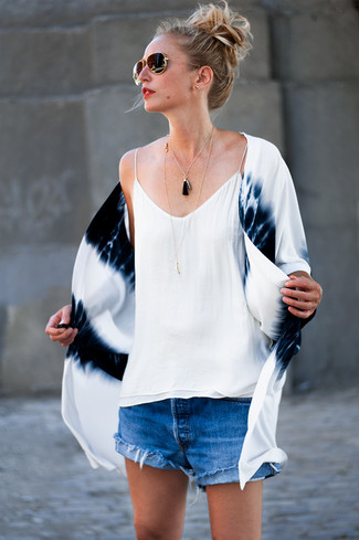 How to wear: white and navy tie-dye kimono, white silk tank, blue denim shorts, black and gold sunglasses