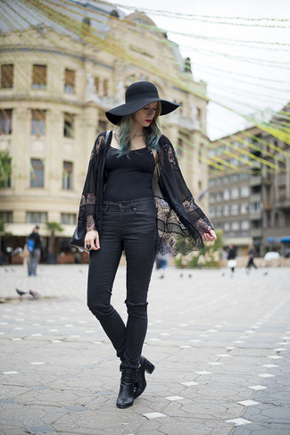 How to wear: black lace kimono, black tank, black ripped skinny jeans, black cutout leather ankle boots
