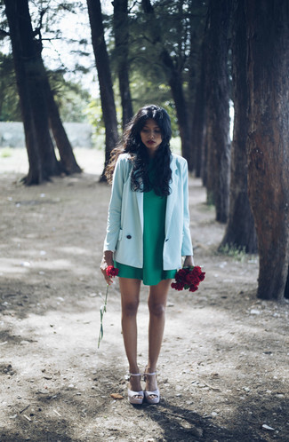 Effortlessly blurring the line between chic and casual, this combination of a baby blue jacket and a green shift dress is likely to become one of your favorites. Mix things up by wearing pale pink leather wedge sandals.