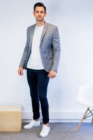Light Blue Blazer Outfits For Men: Undeniable proof that a light blue blazer and navy skinny jeans are amazing when combined together in a casual look. The whole ensemble comes together if you add a pair of white canvas low top sneakers to the equation.