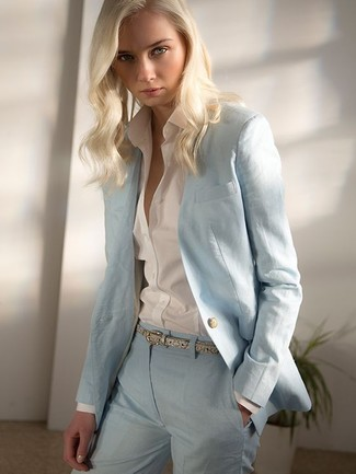 Consider pairing a light blue blazer with light blue slacks for a refined yet off-duty ensemble. With springtime approaching, it's time to put on simple and stylish ensembles, just like this.