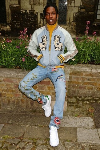 How to wear: light blue embroidered bomber jacket, mustard turtleneck, light blue embroidered jeans, white leather low top sneakers