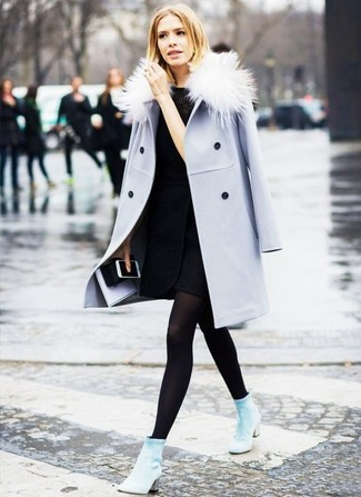 Choose a light blue coat and a black wool fitted dress to achieve a neat and proper look. Complement this look with light blue suede ankle boots.