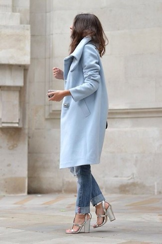 Wear a light blue coat and blue ripped jeans for a casual level of dress. A pair of silver leather heeled sandals will seamlessly integrate within a variety of outfits.