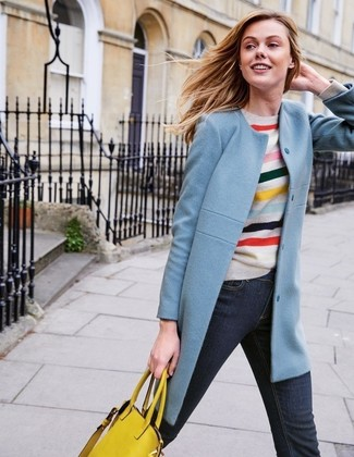 How to wear: light blue coat, multi colored horizontal striped crew-neck sweater, navy jeans, yellow leather tote bag