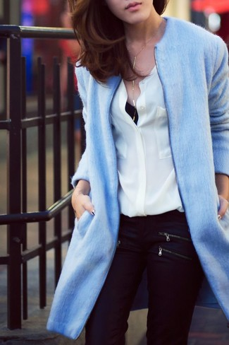 Pairing a light blue coat with black skinny jeans is a comfortable option for running errands in the city.