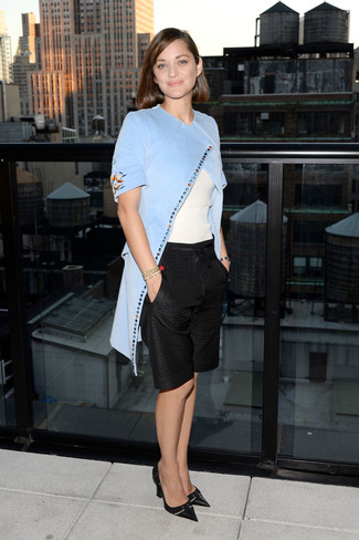 Marion Cotillard wearing Light Blue Coat, White Short Sleeve Sweater, Black Bermuda Shorts, Black Leather Pumps