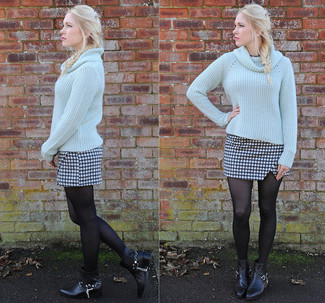 The versatility of a light blue cowl-neck sweater and a black and white check mini skirt makes them investment-worthy pieces. You could perhaps get a little creative in the shoe department and lift up your look with black studded leather ankle boots. Loving this one, especially for springtime.