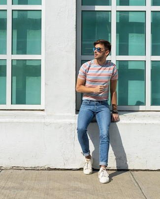 How to wear: light blue horizontal striped crew-neck t-shirt, blue jeans, white low top sneakers, blue sunglasses