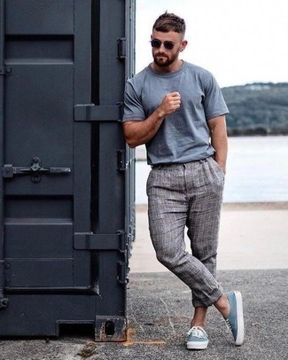 How to Wear a Light Blue Crew-neck T-shirt For Men: A light blue crew-neck t-shirt and grey plaid chinos are the ideal way to infuse extra cool into your day-to-day casual arsenal. Light blue canvas low top sneakers finish this outfit very well.