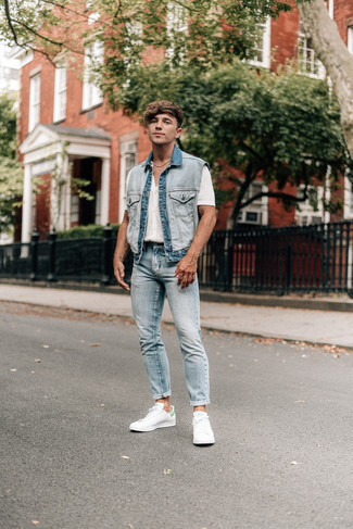 Light Blue Denim Gilet Outfits For Men: Try pairing a light blue denim gilet with light blue jeans to put together a daily ensemble that's full of style and character. Add a pair of white and green leather low top sneakers to this ensemble and ta-da: the outfit is complete.