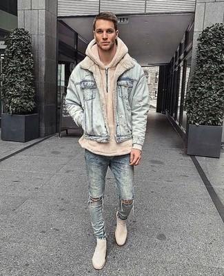 How to wear: light blue denim jacket, beige hoodie, light blue ripped skinny jeans, beige suede chelsea boots