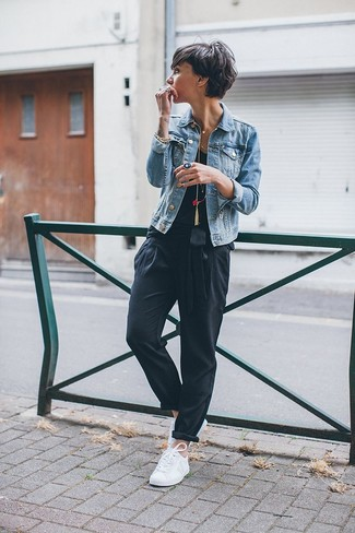 A nicely put together combination of a light blue jean jacket and black tapered pants will set you apart effortlessly. A pair of white low top sneakers will be a stylish addition to your outfit.