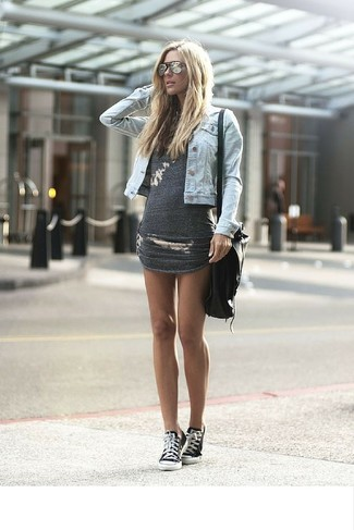 How to wear: light blue denim jacket, charcoal bodycon dress, black and white canvas low top sneakers, black leather crossbody bag