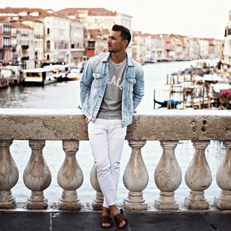How to wear: light blue denim jacket, grey print crew-neck t-shirt, white jeans, dark brown leather sandals